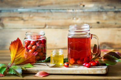 Rosehip tea and berries with honey